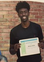 abebe_with_certificate.jpg